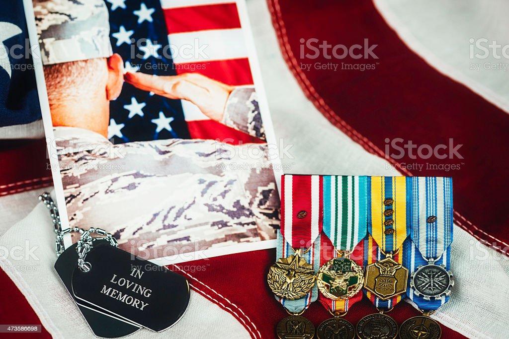 US Memorial Day. Veterans Day. Military Memorial with soldier. Medals US Memorial Day. Veterans Day. Military Memorial with soldier. Medals, dog tags, photo, US flag 2015 Stock Photo