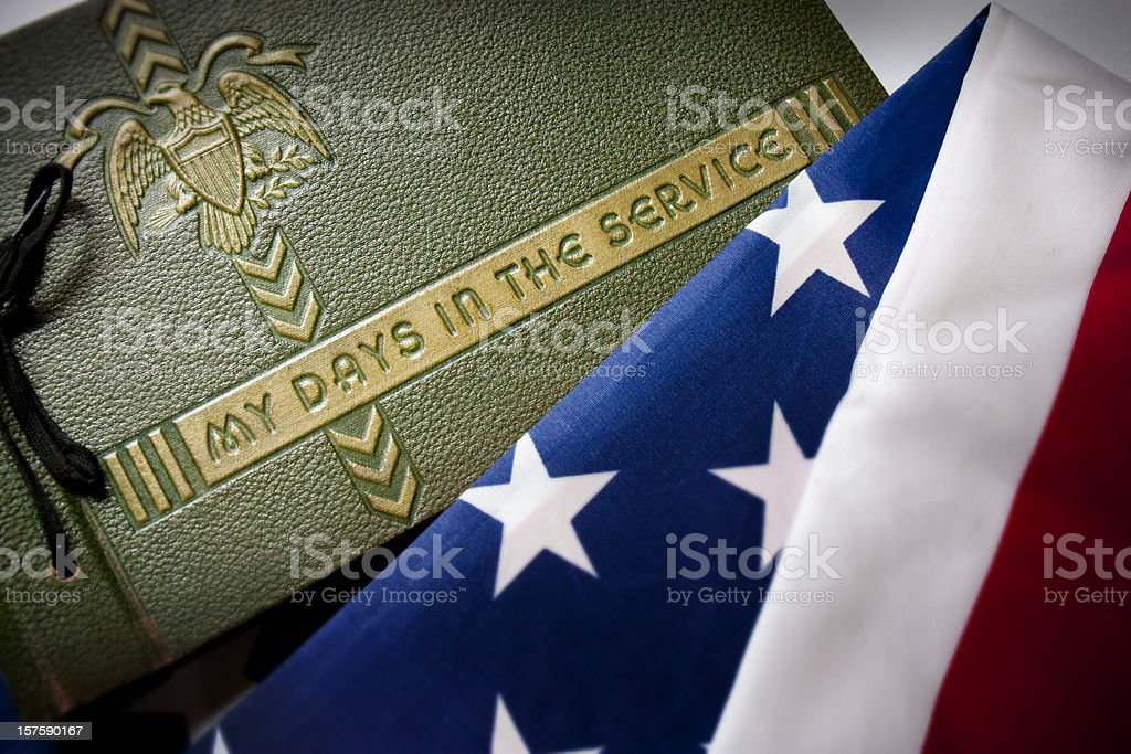 Memorial Day Veteran's Remembrance with Military Service album and flag. royalty-free stock photo