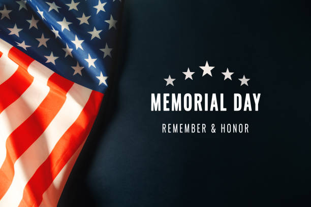 Memorial Day with American flag on blue background stock photo
