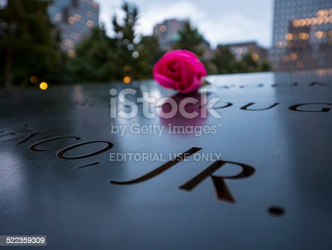 New York City USA - August 14, 2014: Memorial Park 9/11. A rose is offered  to the name of the victim when is his birthday
