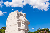 Washington DC, USA - June 2017: The Martin Luther King Jr memorial sculpture stands tall on a sunny blue sky day.