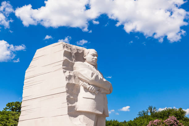 MLK Memorial Washington DC, USA - June 2017: The Martin Luther King Jr memorial sculpture stands tall on a sunny blue sky day. martin luther king jr photos stock pictures, royalty-free photos & images