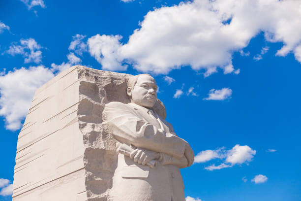 MLK Memorial Washington DC, USA - June 2017: The Martin Luther King Jr memorial sculpture stands tall on a sunny blue sky day. martin luther king jr stock pictures, royalty-free photos & images