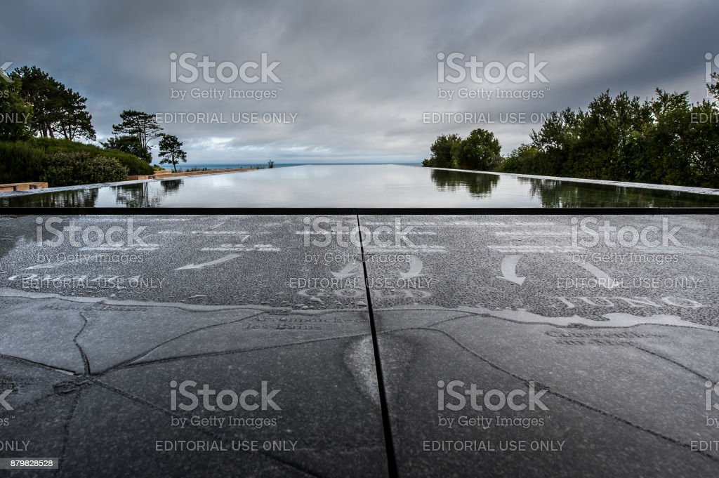 Memorial plaque and artificial pond at the Normandy American Cemetery stock photo