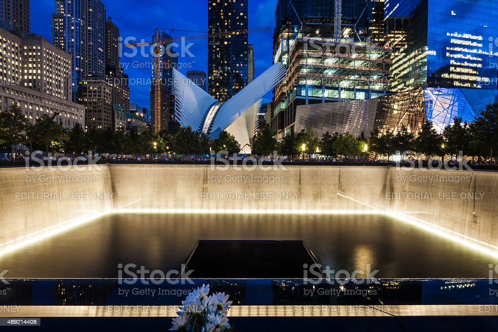 9/11 Memorial pool at night on 9/11 stock photo