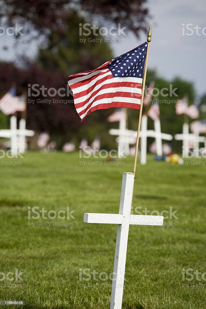 Memorial with white cross and US flag royalty-free stock photo