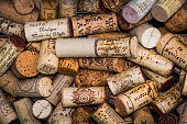 Valduz, Liechtenstein.-May 24, 2016-A close up of an array of discarded wine corks of many vitners outside a cafe in  Valduz, Liechtenstein.
