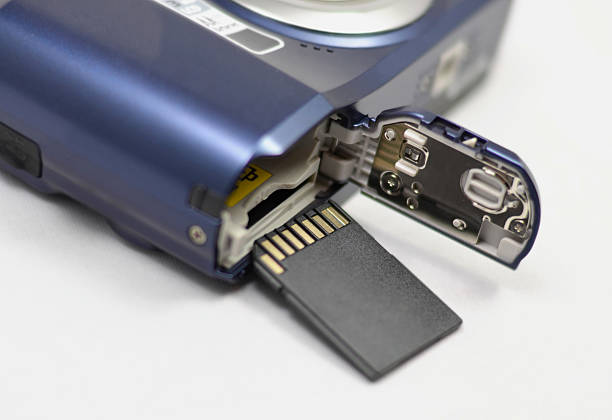 memory card and digital camera - memory card stock photos and pictures