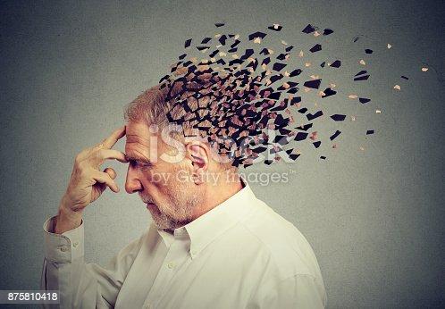 istock Memory loss due to dementia. Senior man losing parts of head  as symbol of decreased mind function. 875810418