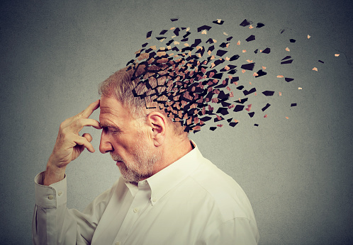istock Memory loss due to dementia. Senior man losing parts of head  as symbol of decreased mind function. 875810418