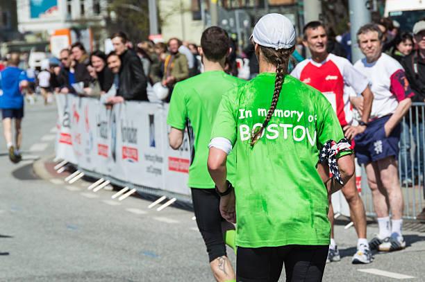memory run for the victims of boston marathon 2013 - boston marathon stock photos and pictures