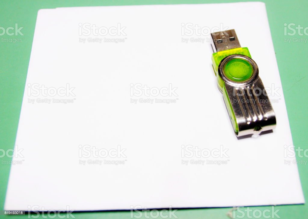 USB memory stick and paper stock photo