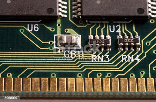A close macro of a older memory module showing paths and components in detail