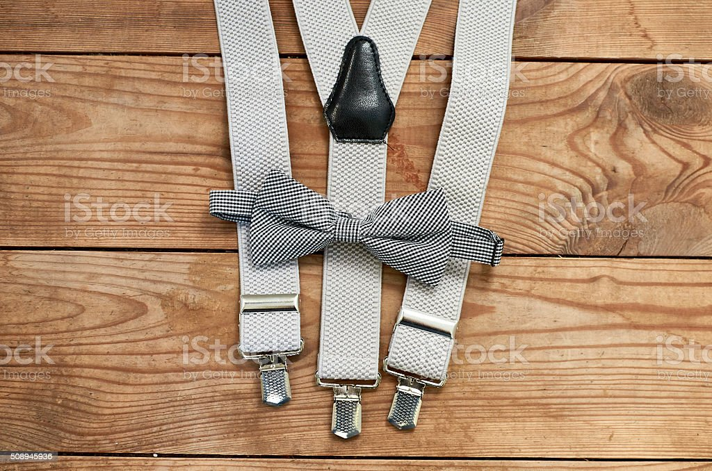 men accessories isolated on wooden background close-up