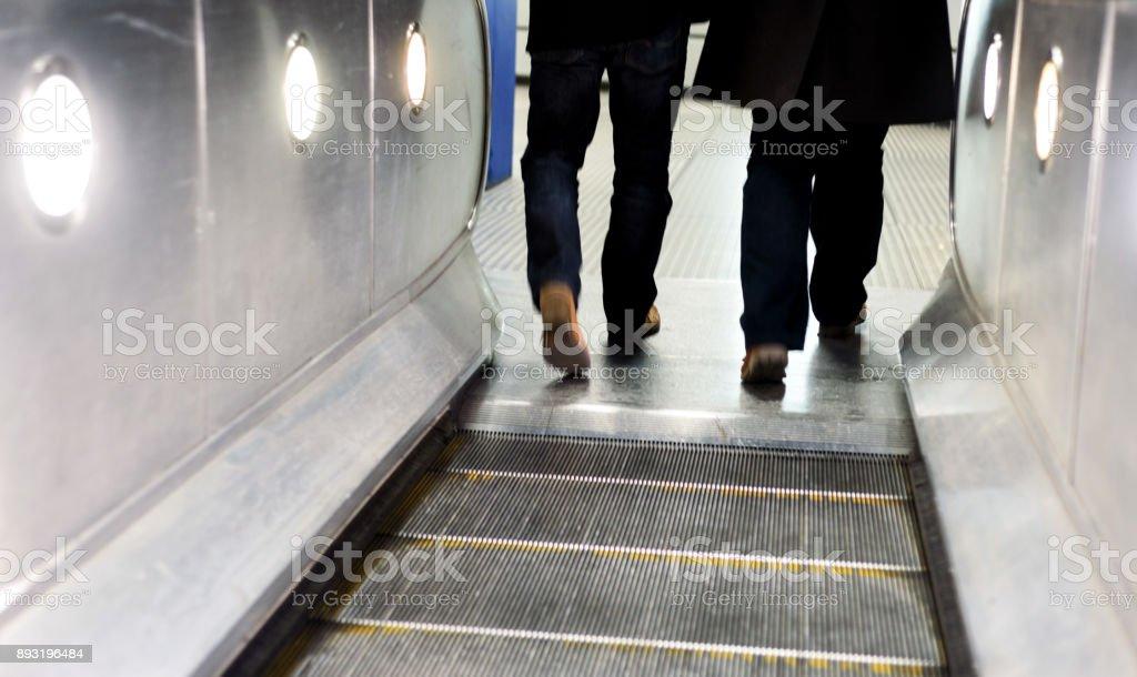 Men and Escalators London Underground stock photo
