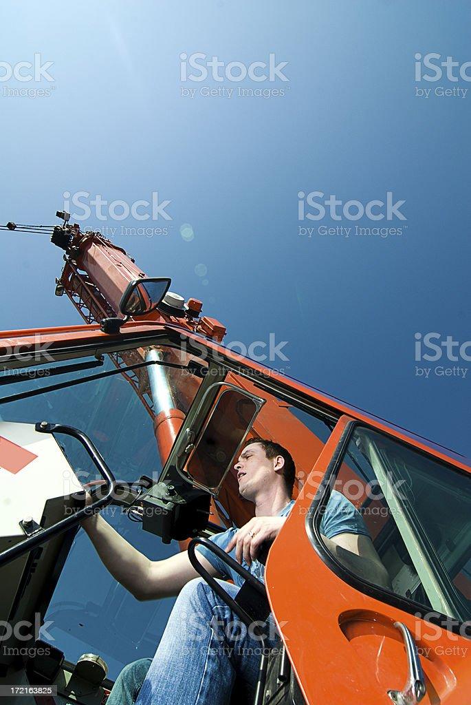 Men and his crane royalty-free stock photo