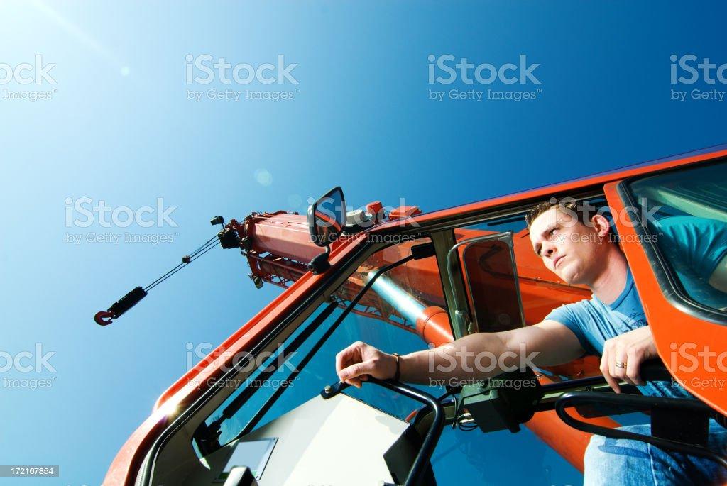 Men and his crane stock photo