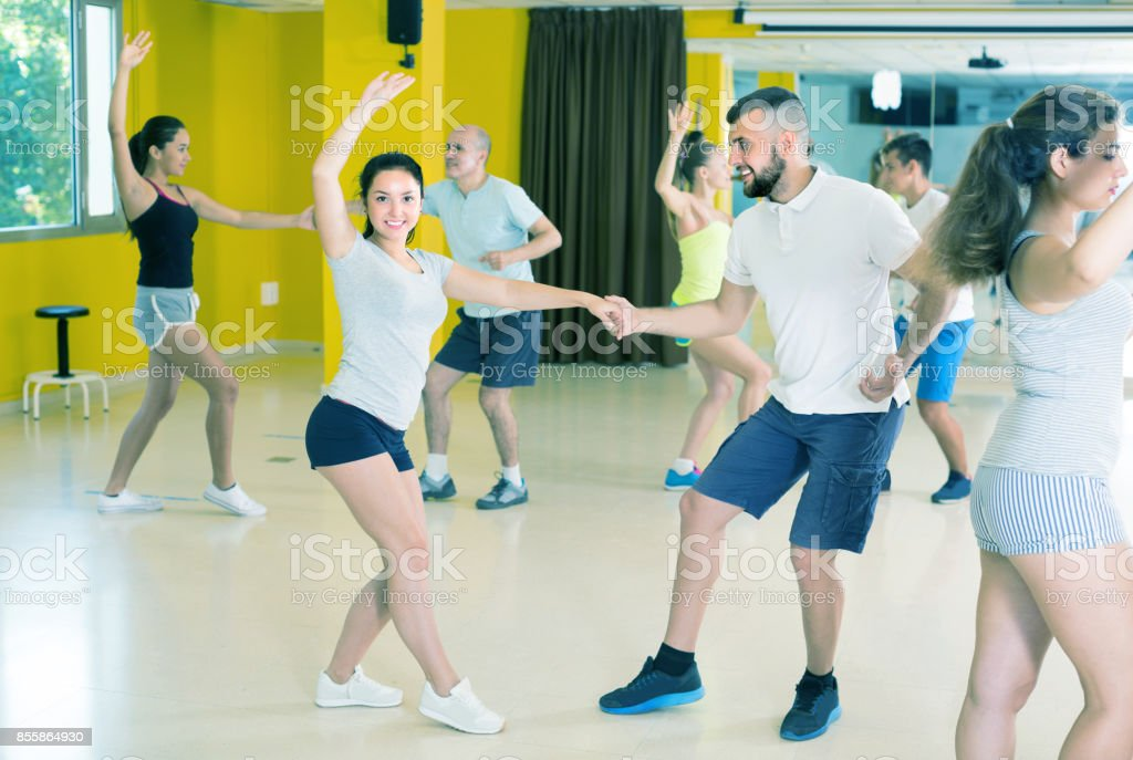 Men and women are dancing boogie-woogie in pairs stock photo