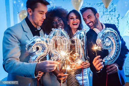 istock Men and women celebrating the new year 2019 1055925372
