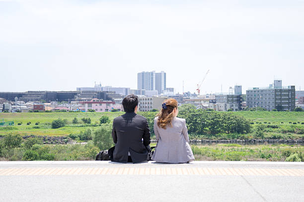 men and women from behind the scenery is sit - satoyama scenery stock photos and pictures