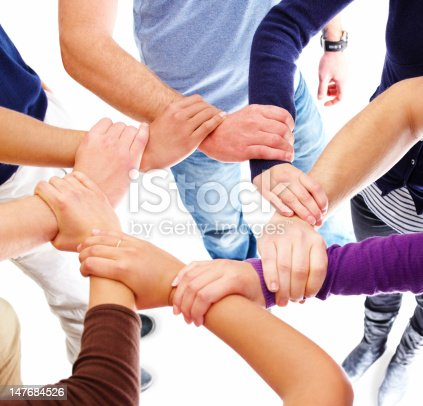 Men and women holding hands of each other