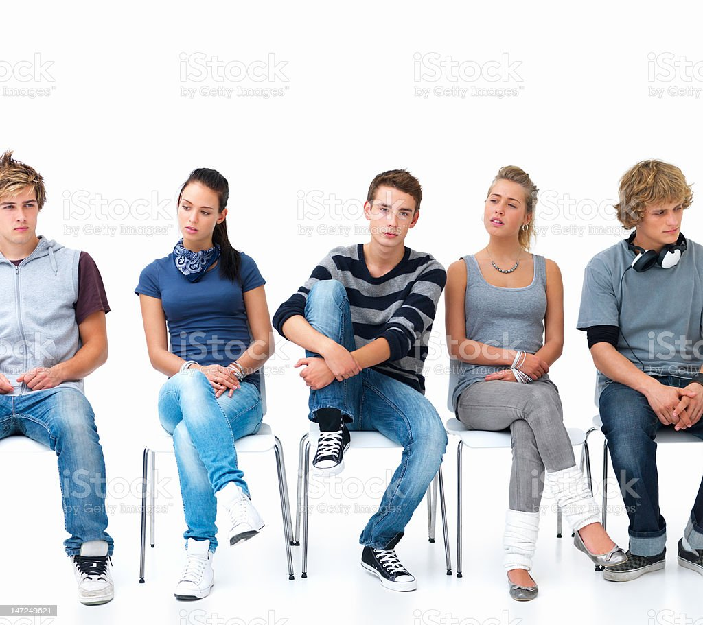 Men and women sitting on chairs in a line royalty-free stock photo