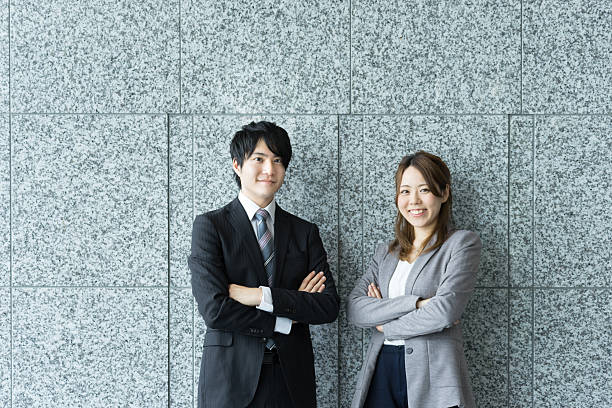 Men and women to be arms folded with smile ストックフォト