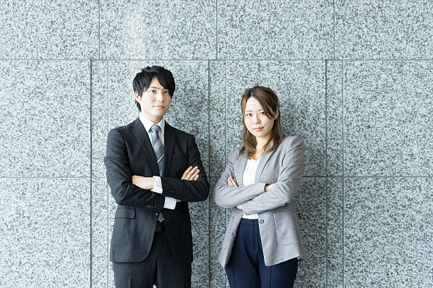 Men and women to be his arms folded (business image) ストックフォト