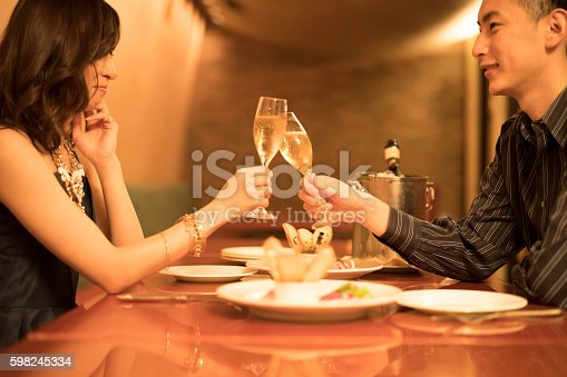 istock Men and women who have a toast at the restaurant 598245334
