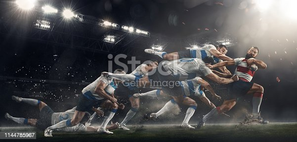 istock Men are playing rugby at stadium 1144785967
