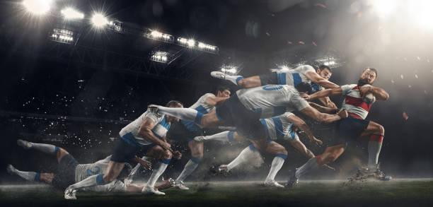 los hombres juegan al rugby en el estadio - rugby fotografías e imágenes de stock
