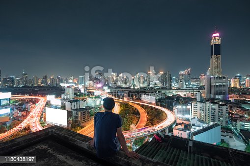istock Men are sitting on balcony with sightseeing the city glowing at night 1130438197