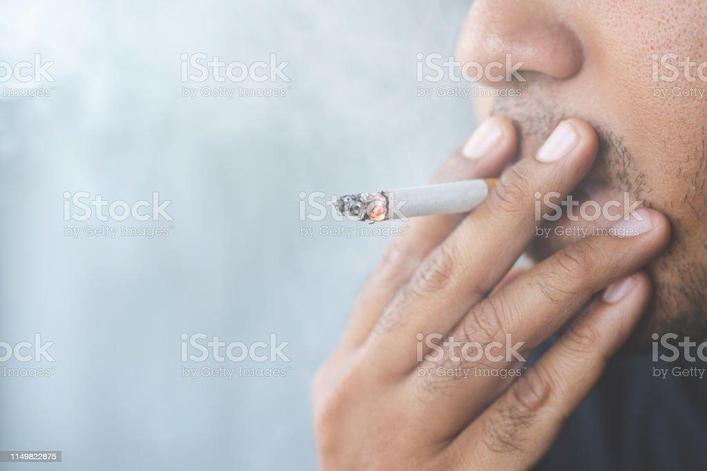 Men are smoking, causing smoke, harmful to life and society.