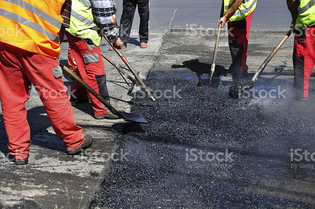 men are working at a road construction royalty-free stock photo