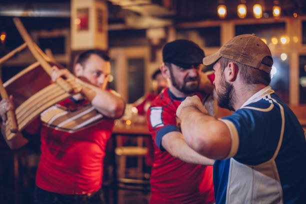 Men arguing in sports bar stock photo