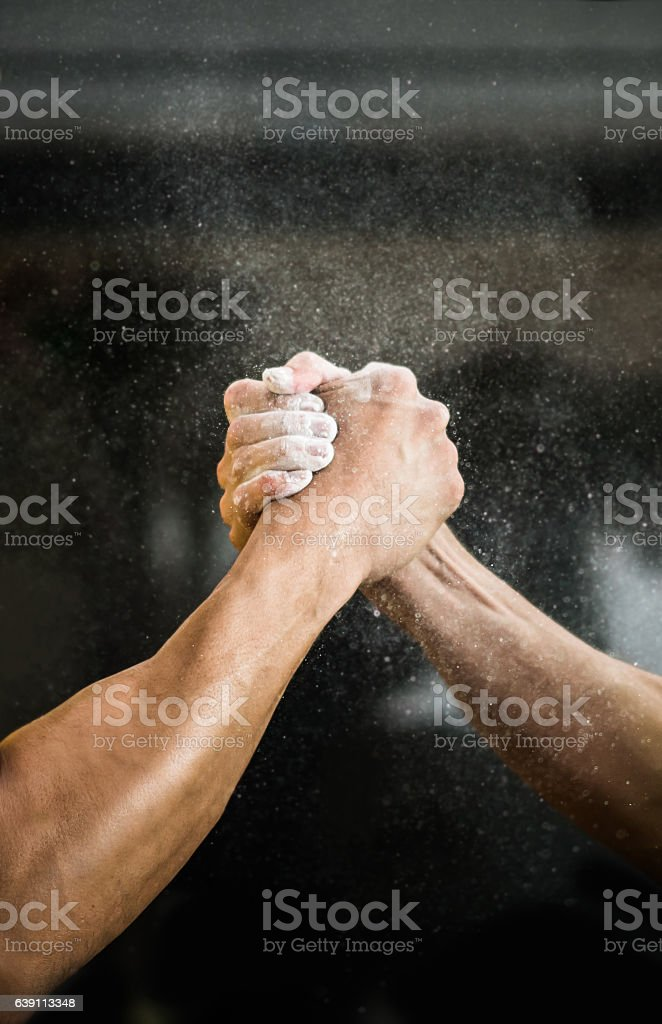 Men arm wrestling at the gym stock photo