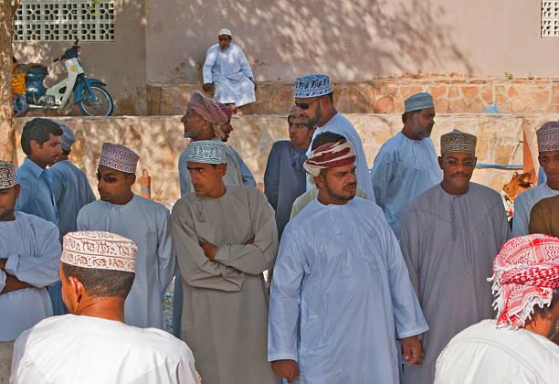Men at a cattle market, Nizwa, Oman stock photo