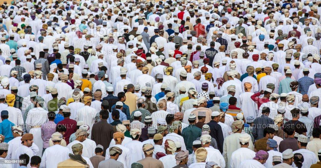 men at a prayers on a morning of Eid Al Fitr stock photo