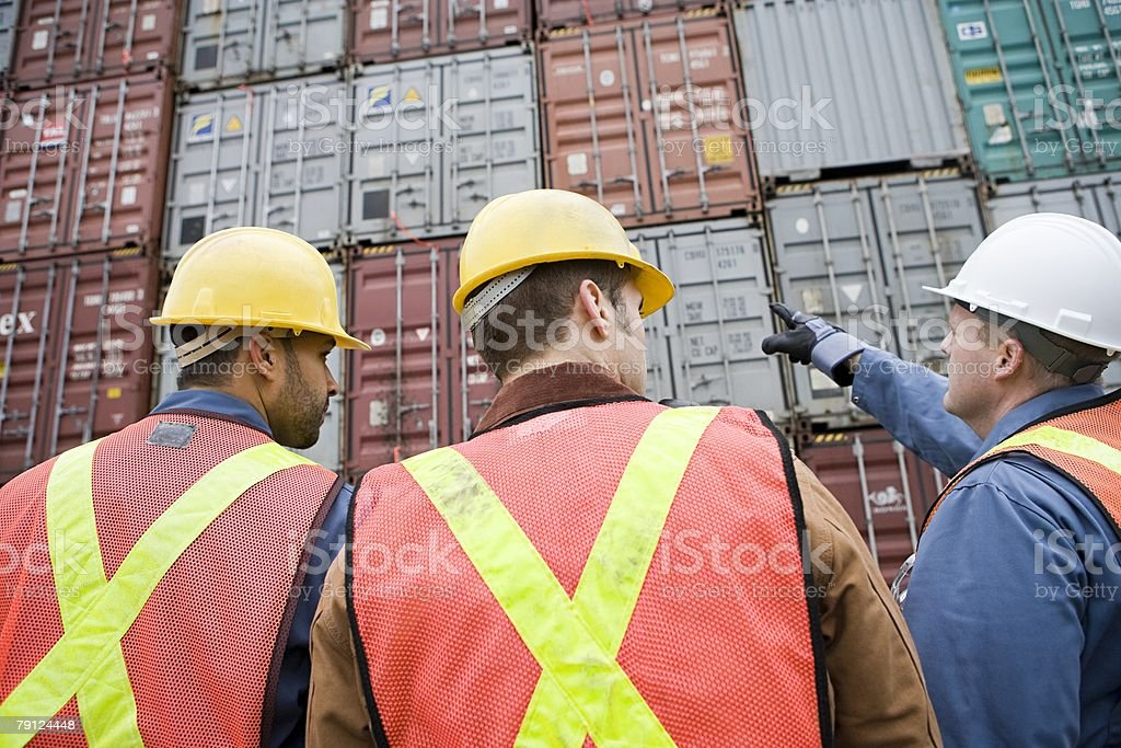 Men at container terminal royalty-free 스톡 사진