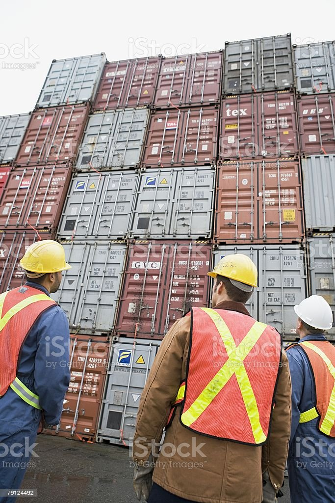 Men at container terminal 免版稅 stock photo