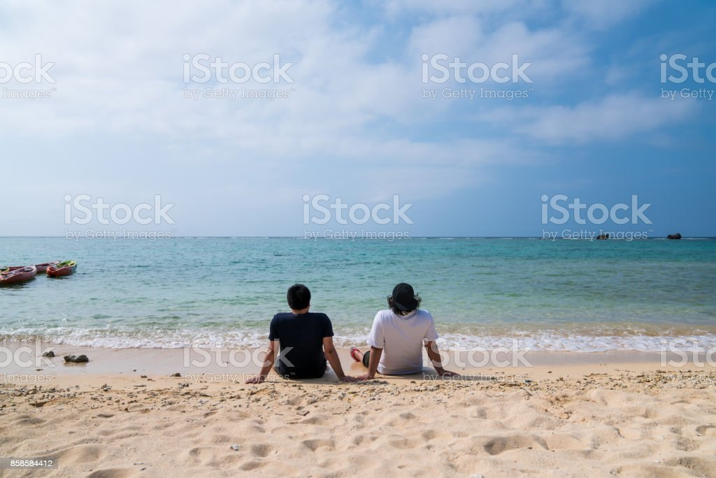 Men at Okinawa beach stock photo