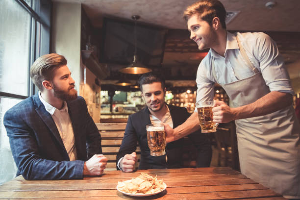 https://media.istockphoto.com/photos/men-at-the-pub-picture-id657432266?k=6&m=657432266&s=612x612&w=0&h=Q3rbxo7EOG-xnLPYyU0PPdDlNar7HL9aVwbrpZfwOOA=