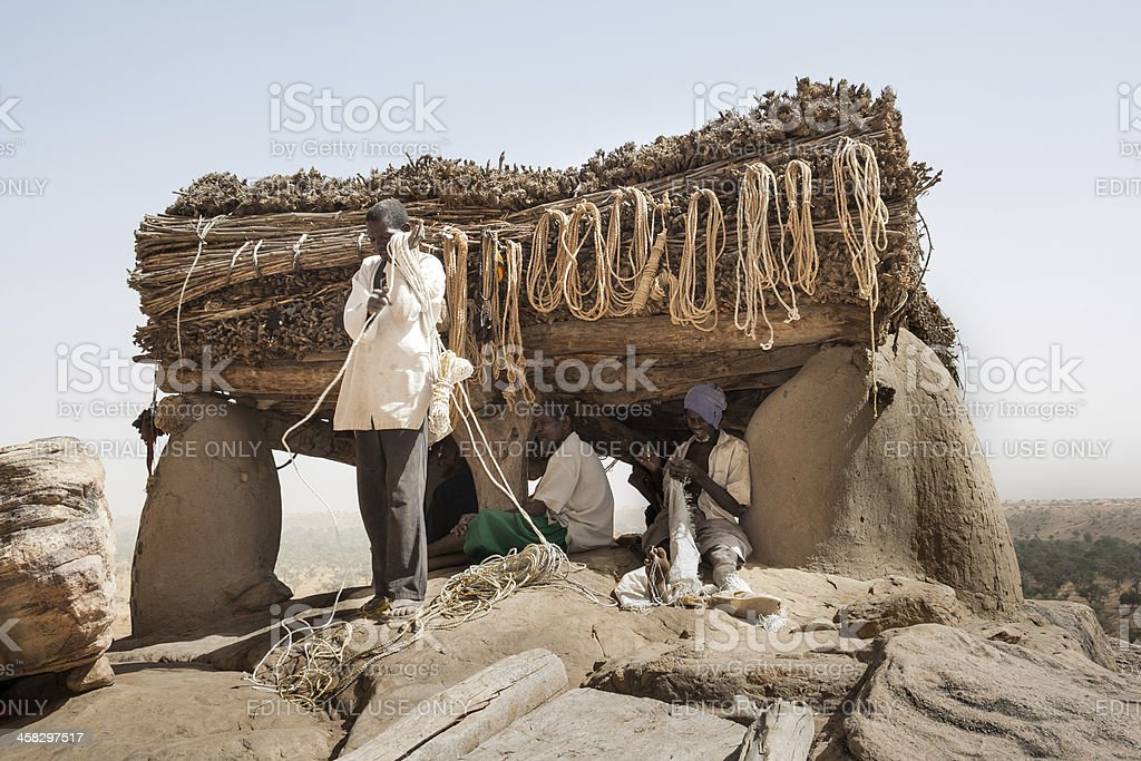 Men at work near Toguna of the village, Mali. stock photo