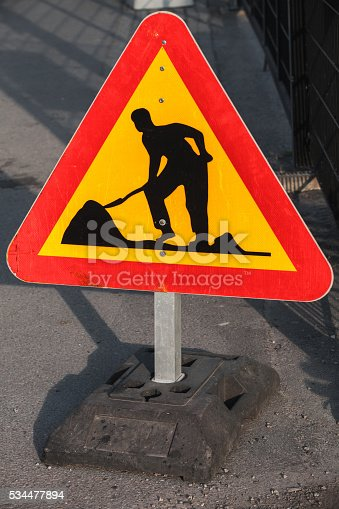 97709303 istock photo Men at work, road under construction sign 534477894