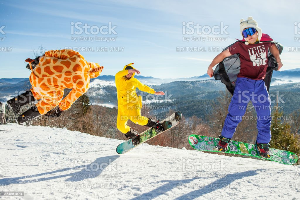 Bukovel, Ukraine - December 22, 2016: Men boarders jumping on his snowboard against the backdrop of mountains, hills and forests in the distance. Bukovel, Carpathian mountains stock photo
