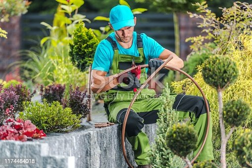 Forty Years Old Caucasian Men Building Garden Irrigation Watering System. Landscaping and Garden Technologies.