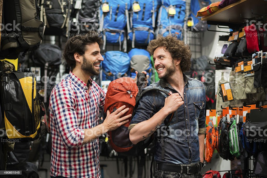 Men buying backpack stock photo