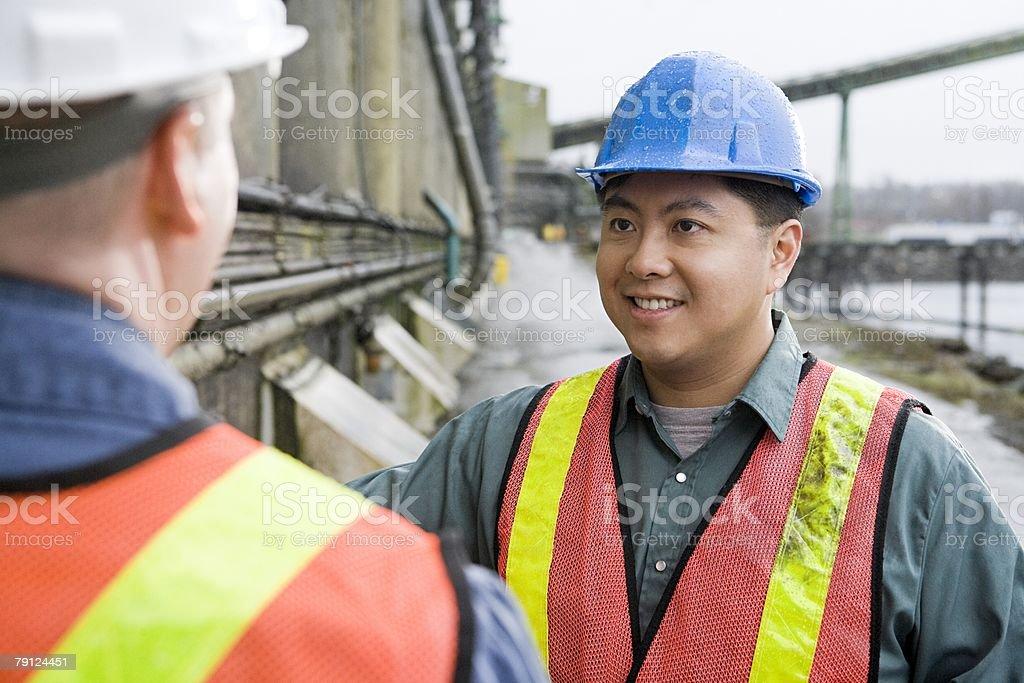 Men by grain elevator 免版稅 stock photo