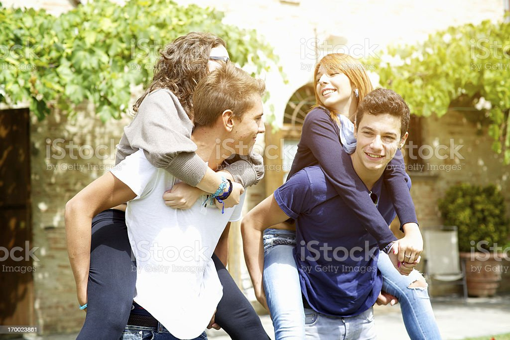 Men carrying their girlfriends on back royalty-free stock photo