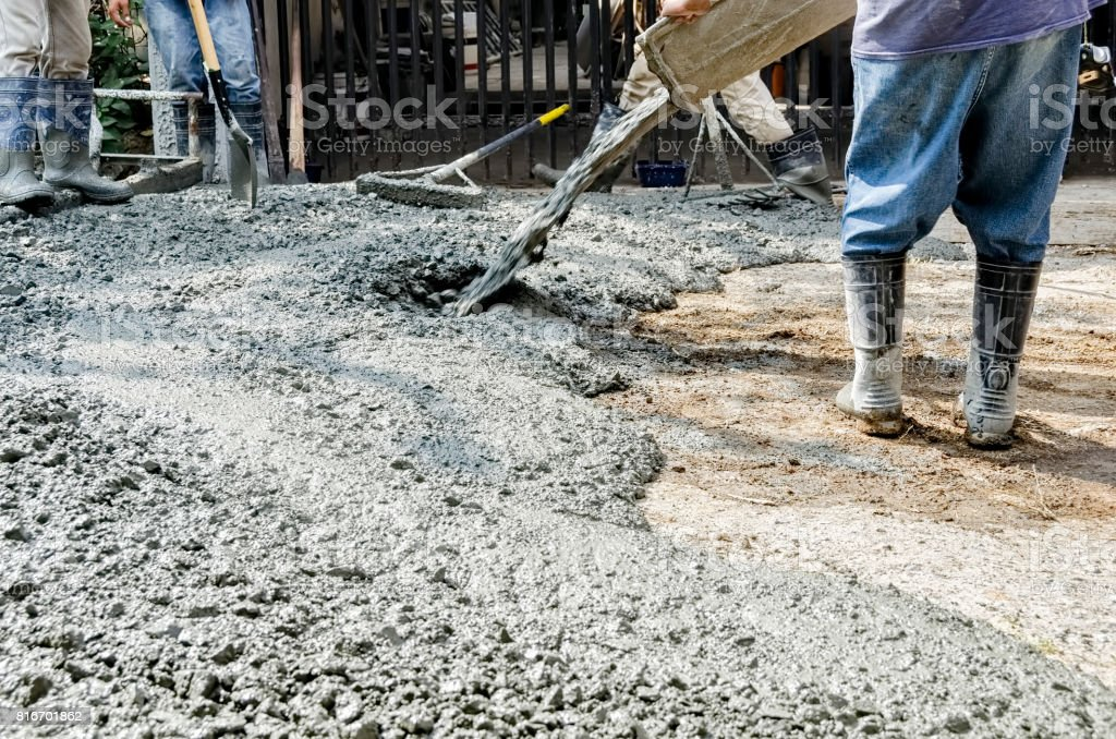 Men Cementing Road stock photo
